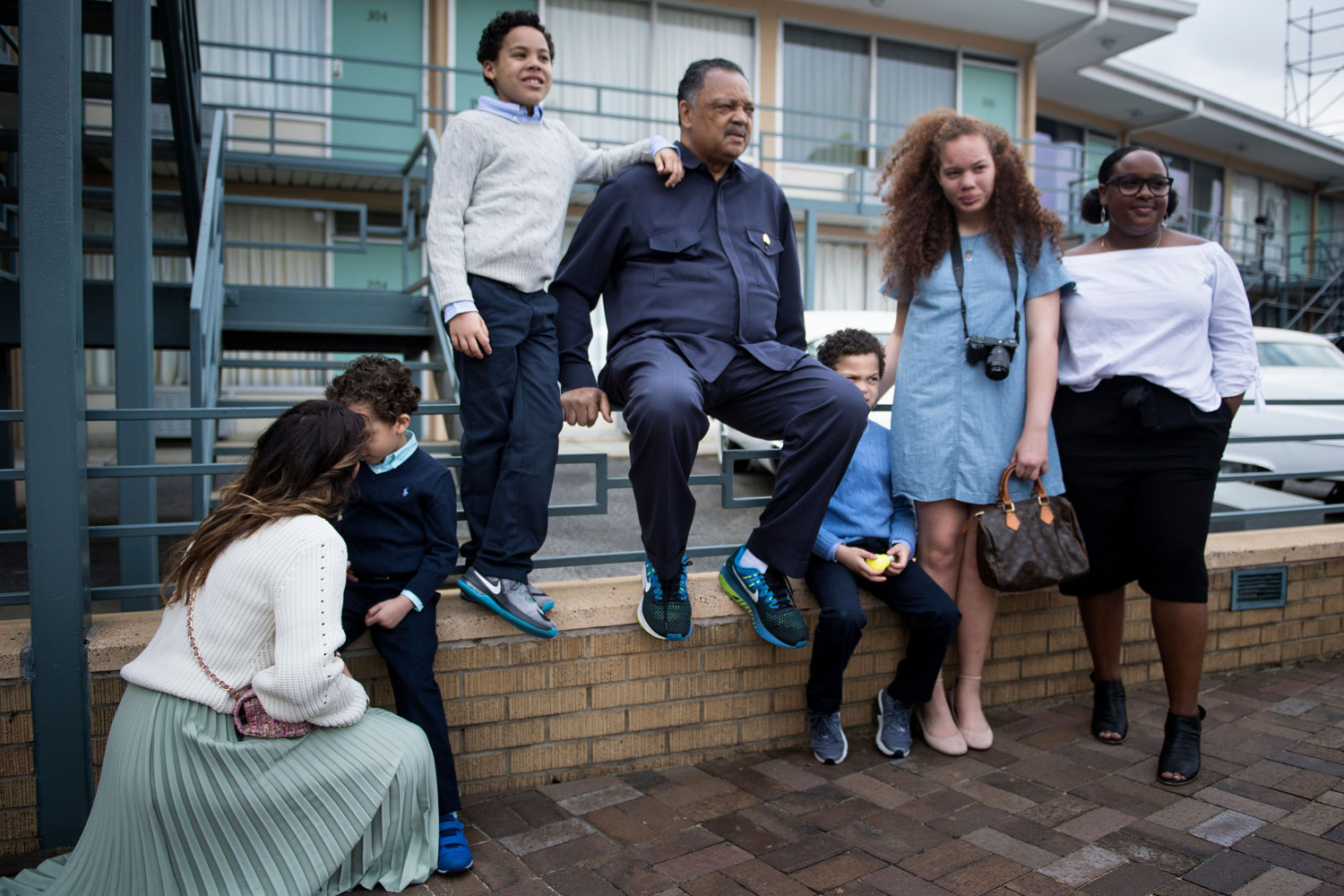 "Rev. Jesse Jackson poses for a photo with family on April 3 outside the Lorraine Motel — now the National Civil Rights Museum — where Martin Luther King Jr. was killed in 1968. Jackson was part of King's entourage at the hotel 50 years ago and told CNN this year that the events of that day are ""a wound that remains raw."" (Brendan Smialowski/AFP/Getty Images)"