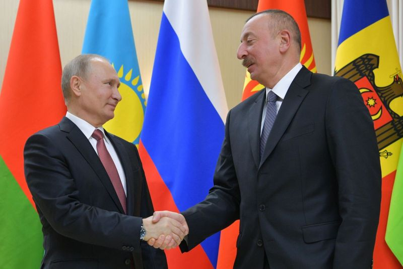 Russian President Vladimir Putin welcomes Azerbaijani President Ilham Aliyev ahead of an informal Commonwealth of Independent States leaders summit at the Novo-Ogaryovo state residence outside Moscow on Dec. 26, 2017. (Alexey Druzhinin/AFP/Getty Images)