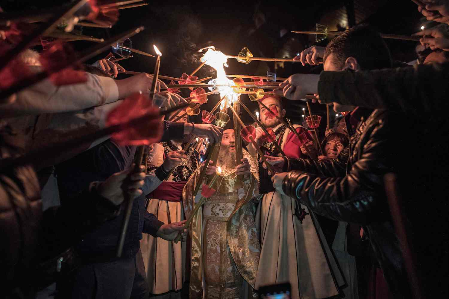 Macedonian Orthodox worshippers light candles from the holy fire that arrived from Jerusalem during the Easter service at the St. Jovan Bigorski monastery, some 145 km west of the capital Skopje,April 8, 2018.