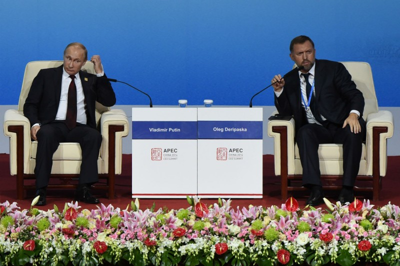 Russia's President Vladimir Putin and Oleg Deripaska, CEO of UC Rusal, attend the APEC CEO Summit on Nov. 10, 2014 in Beijing, China. (Wang Zhao-Pool/Getty Imgaes)