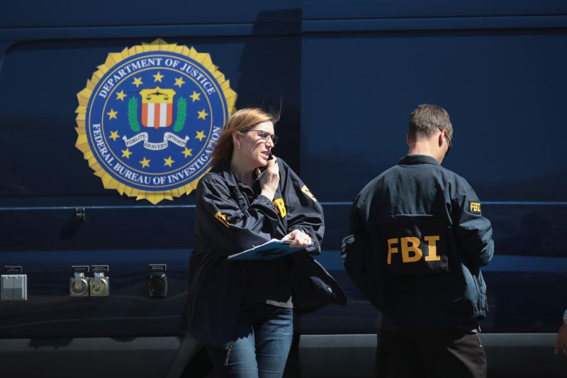 FBI agents collect evidence at a FedEx Office facility following an explosion at a nearby sorting center on March 20, in Sunset Valley, Texas. (Scott Olson/Getty Images)