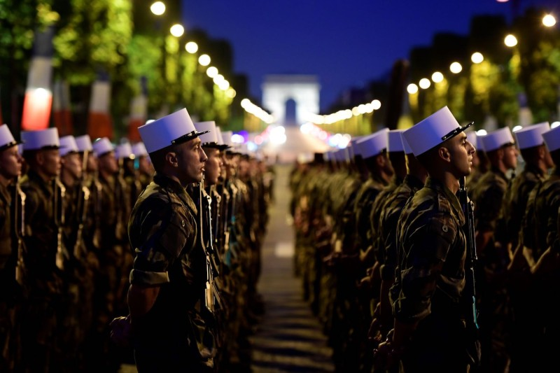 Soldiers from the Foreign Legion march down the Champs Elysees, with the Arc de Triomphe in the background,  in Paris during a rehearsal of the annual Bastille Day military parade on July 10, 2017. (Martin Bureau/AFP/Getty Images)