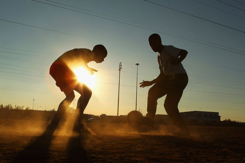 Children play soccer in Johannesburg, South Africa on June 7, 2010. (Cameron Spencer/Getty Images)