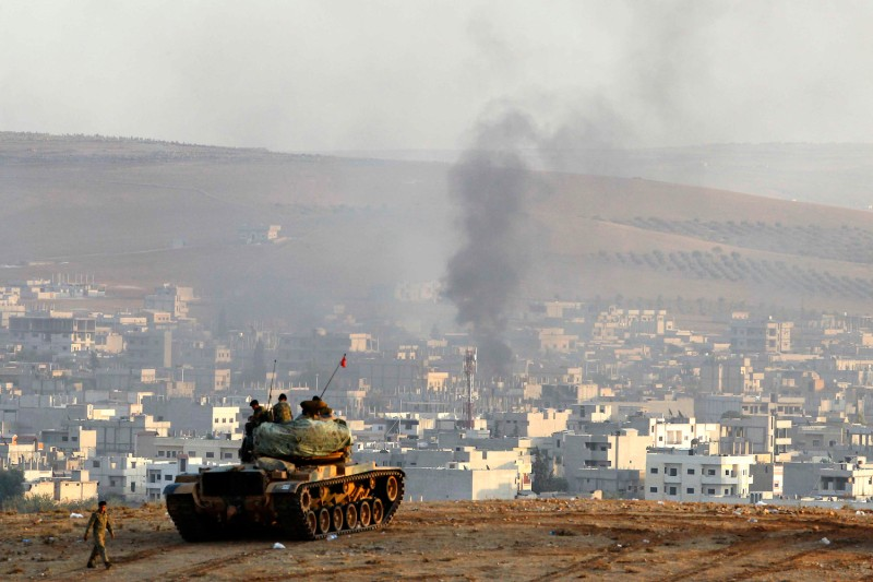 A Turkish tank on a hilltop overlooking the Turkey-Syria border on Oct. 9, 2014. (Gokhan Sahin/Getty Images)