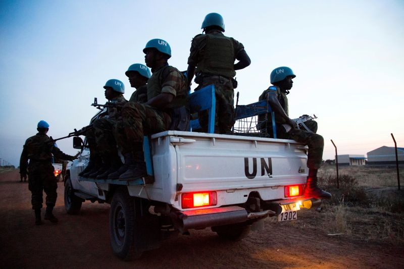 Peacekeeper troops from Ethiopia and deployed in the United Nations (UN) Interim Security Force for Abyei (UNISFA) patrol in a UN vehicle at night in Abyei town, Abyei state, on December 14, 2016. (ALBERT GONZALEZ FARRAN/AFP/Getty Images)