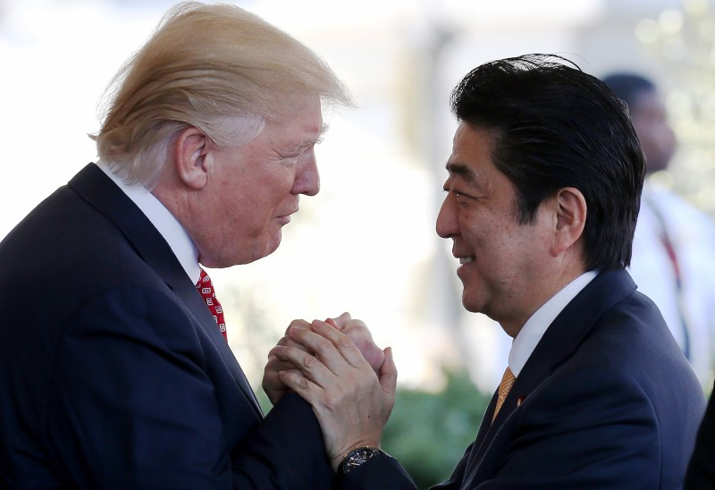 U.S. President Donald Trump greets Japanese Prime Minister Shinzo Abe as he arrives at the White House on Feb. 10, 2017. (Mario Tama/Getty Images)