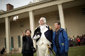 An actor portrays President George Washington as he poses for a selfie with visitors at the Mount Vernon Estate in Mount Vernon, Virginia, on Feb. 22, 2017. (Chip Somodevilla/Getty Images)