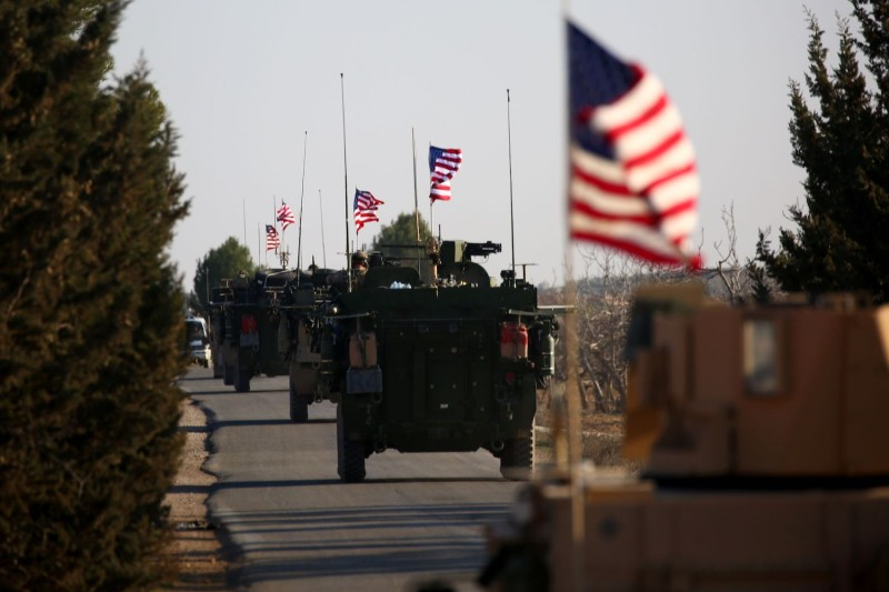 A convoy of U.S. armored vehicles near the northern Syrian city of Manbij, on March 5, 2017. (Delil Souleiman/AFP/Getty Images)