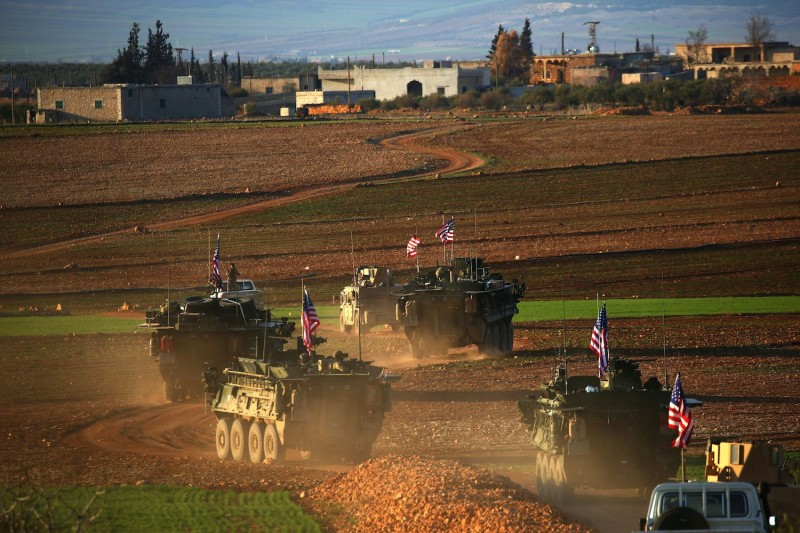 A U.S. convoy of armored vehicles on the outskirts of the Syrian city of Manbij on March 5, 2017. (Delil Souleiman/AFP/Getty Images)