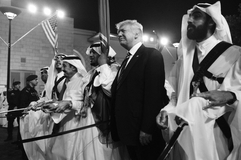 Donald Trump joins dancers with swords at a welcome ceremony ahead of a banquet at Murabba Palace in Riyadh on May 20, 2017. (MANDEL NGAN/AFP/Getty Images)