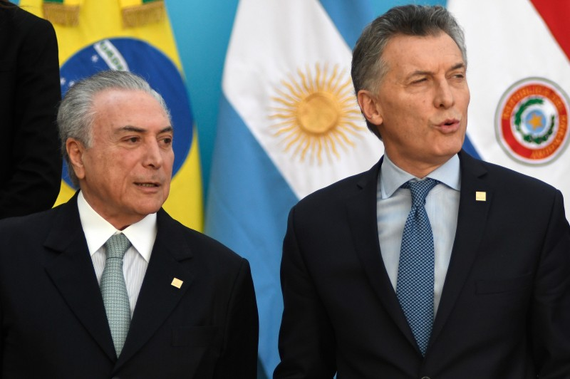 Brazilian president Michel Temer (L) and Argentine President  Mauricio Macri arrive to pose for the official picture at the end of the Mercosur Summit in mendoza, 1080 km west of buenos Aires on July 21, 2017. / AFP PHOTO / Andres Larrovere        (Photo credit should read ANDRES LARROVERE/AFP/Getty Images)