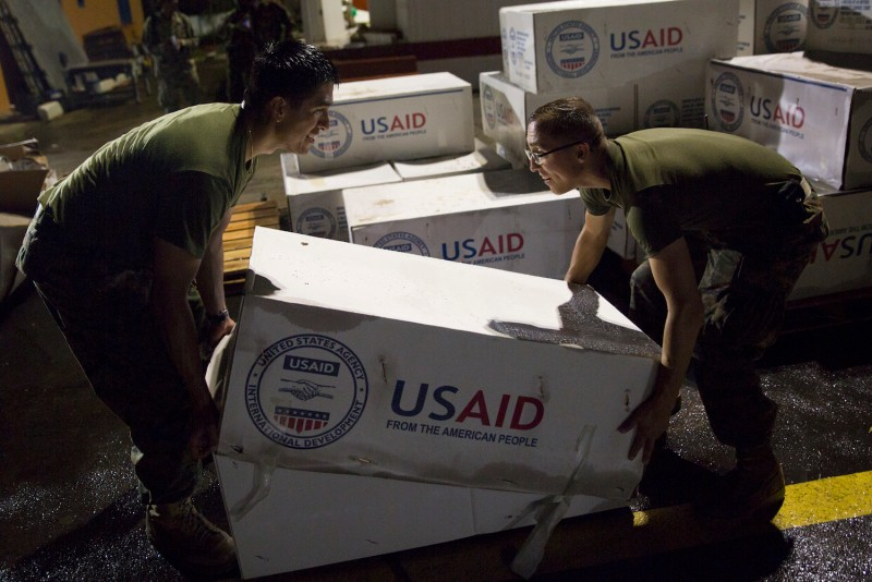 U.S. Marines stack hurricane relief supplies from the U.S. Agency for International Development in Dominica on Sept 29, 2017. (Sgt. Melissa Martens/U.S. Marines via Getty Images)