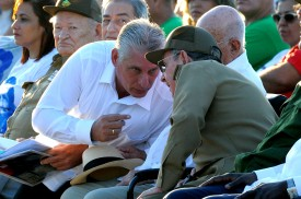 """Raul Castro talks with First Vice President Miguel Diaz Canel, during the homage for the 50th anniversary of Ernesto """"Che"""" Guevara's death, in Santa Clara, Cuba, on Oct. 8, 2017. (YAMIL LAGE/AFP/Getty Images)"""
