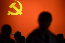 A Chinese Communist Party flag is displayed at an exhibition showcasing China's progress in the past five years at the Beijing Exhibition Center on Oct. 10, 2017. (Wang Zhao/AFP/Getty Images)