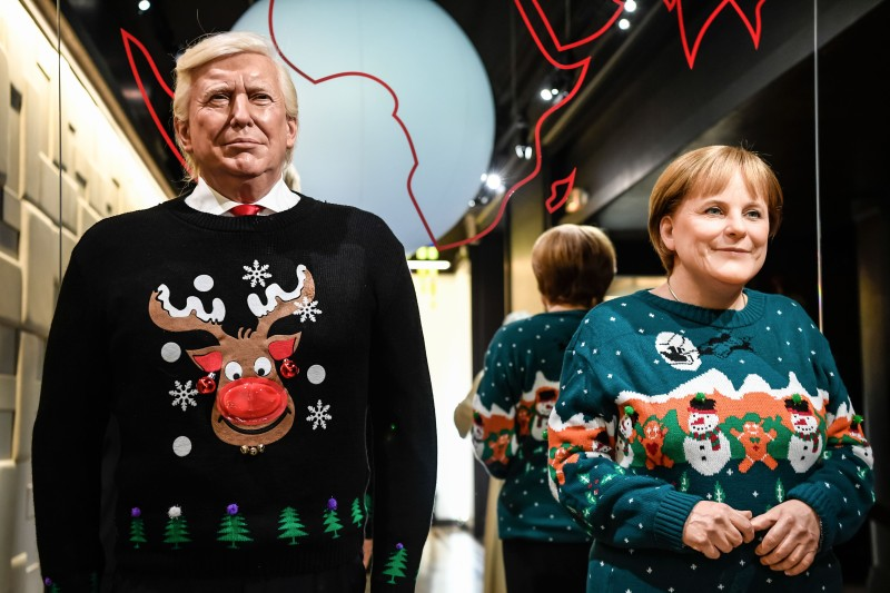 The wax figures of U.S. President Donald Trump and German Chancellor Angela Merkel are pictured in Christmas-themed sweaters at the Grevin Wax Museum in Paris on Dec. 1, 2017. (Bertrand Guay/AFP/Getty Images)