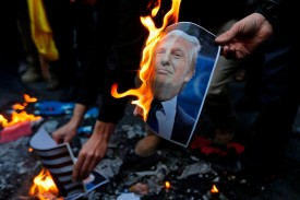 Demonstrators burn a photo of U.S. President Donald Trump in Tehran on December 11, 2017. (Atta Kenare/AFP/Getty Images)