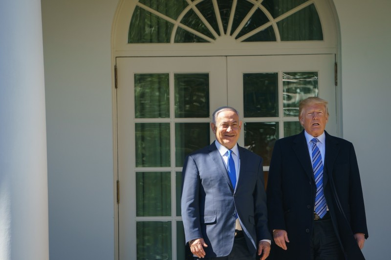 U.S. President Donald Trump poses for a photo with Israeli Prime Minister Benjamin Netanyahu in the Rose Garden of the White House on March 5, 2018. (Andel Ngab/AFP/Getty Images)