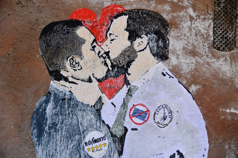 A mural depicting Five Star Mouvement leader Luigi Di Maio kissing the Lega leader Matteo Salvini on a wall in downtown Rome on March 23, 2018. (TIZIANA FABI/AFP/Getty Images)