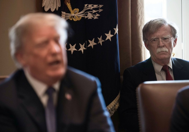 National Security Advisor John Bolton listens to President Donald Trump speak during a cabinet meeting at the White House on April 9. (Nicholas Kamm/AFP/Getty Images)