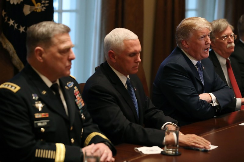 U.S. President Donald Trump speaks during a briefing on Syria in the White House on April 9. From left: U.S. Army Chief of Staff Mark Milley, Vice President Mike Pence, Trump, and National Security Advisor John Bolton. (Mark Wilson/Getty Images)