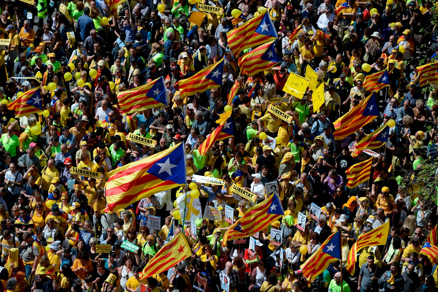 Protesters wave Catalan pro-independence flags during a demonstration to support jailed leaders and politicians in Barcelona on April 15. Thousands marched to protest the jailing of nine Catalan separatist leaders facing trial on rebellion charges for their roles in last year's failed effort to break off from Spain. JOSEP LAGO/AFP/Getty Images