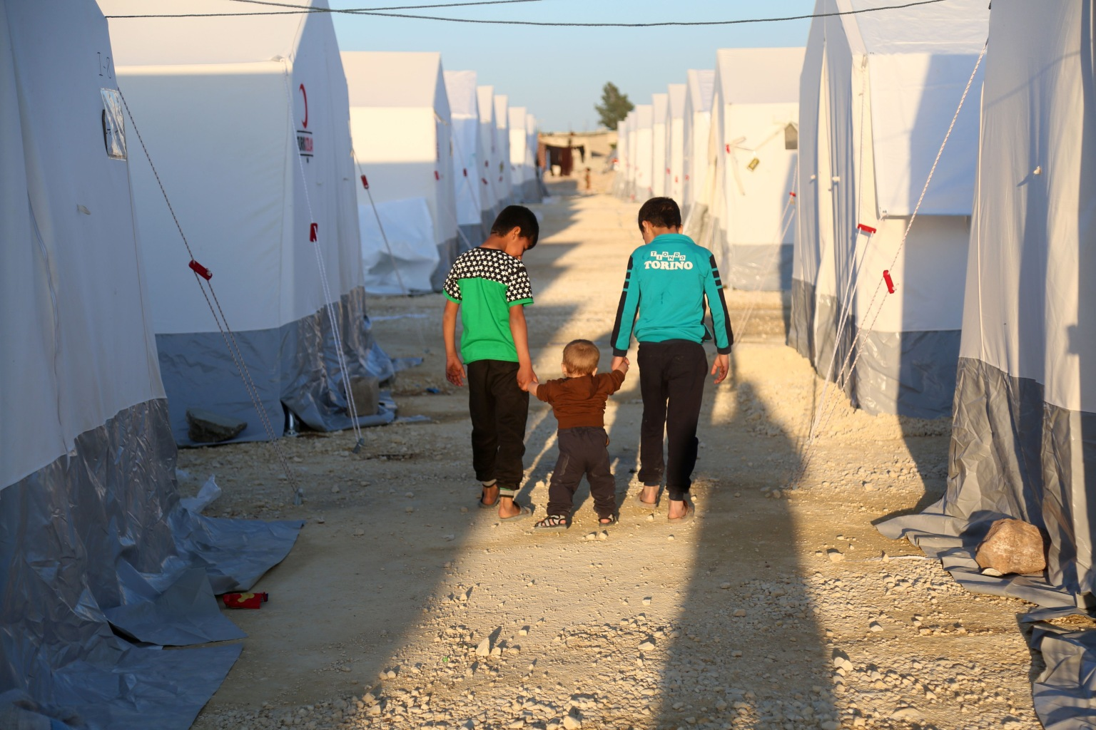 Children walk at a camp for displaced Syrians east of the rebel-held town of Azaz in northern Syria on April 15. ZEIN AL RIFAI/AFP/Getty Images