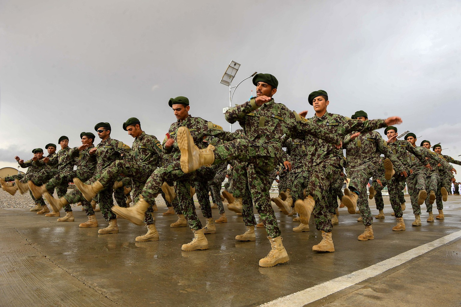 Afghan National Army soldiers march during a graduation ceremony at a training center in Herat province on April 15. HOSHANG HASHIMI/AFP/Getty Images