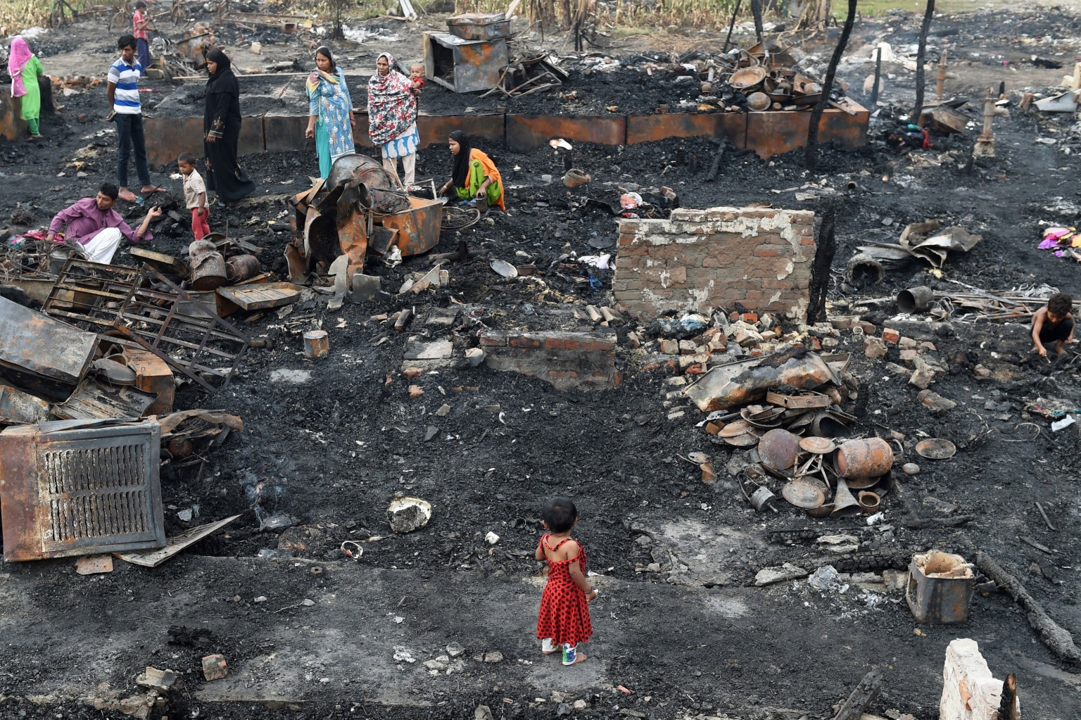 Rohingya refugees look for their belongings in New Delhi on April 16 following a fire that broke out at their camp, leaving around 200 people homeless. The refugees fled persecution in Myanmar, with their numbers increasing following a brutal crackdown in September 2017 that saw hundreds of thousands pouring into neighbouring Bangladesh. MONEY SHARMA/AFP/Getty Images