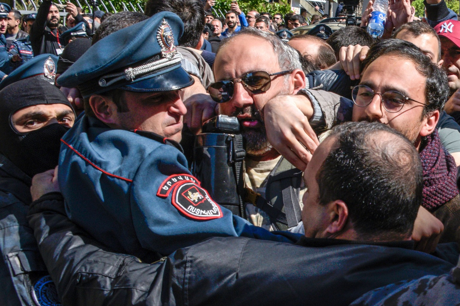 Armenian policemen try to stop opposition supporters during a rally in central Yerevan on April 16. Around 1,000 protesters staged rallies in the Armenian capital against former president Serzh Sarkisian as he moves to maintain a chokehold on power as prime minister of the former Soviet nation. KAREN MINASYAN/AFP/Getty Images