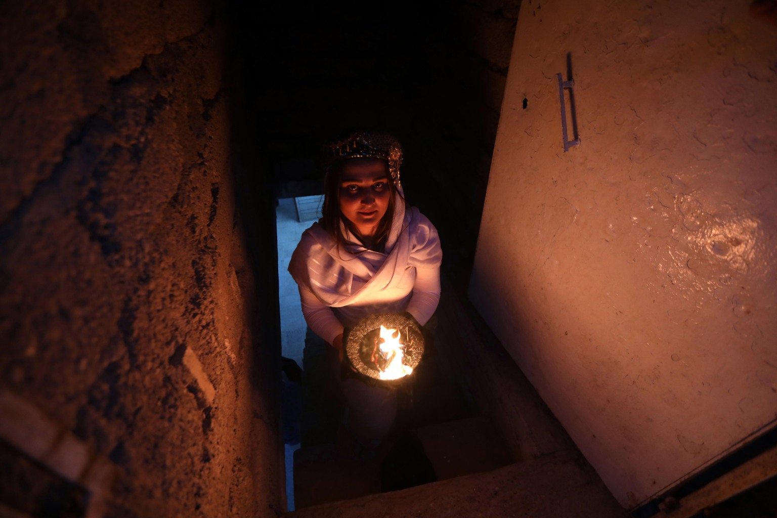 An Iraqi Yazidi carries a candle inside Lalish temple near Dohuk, 260 miles northwest of Baghdad, during a ceremony to celebrate the Yazidi New Year on April 17. SAFIN HAMED/AFP/Getty Images