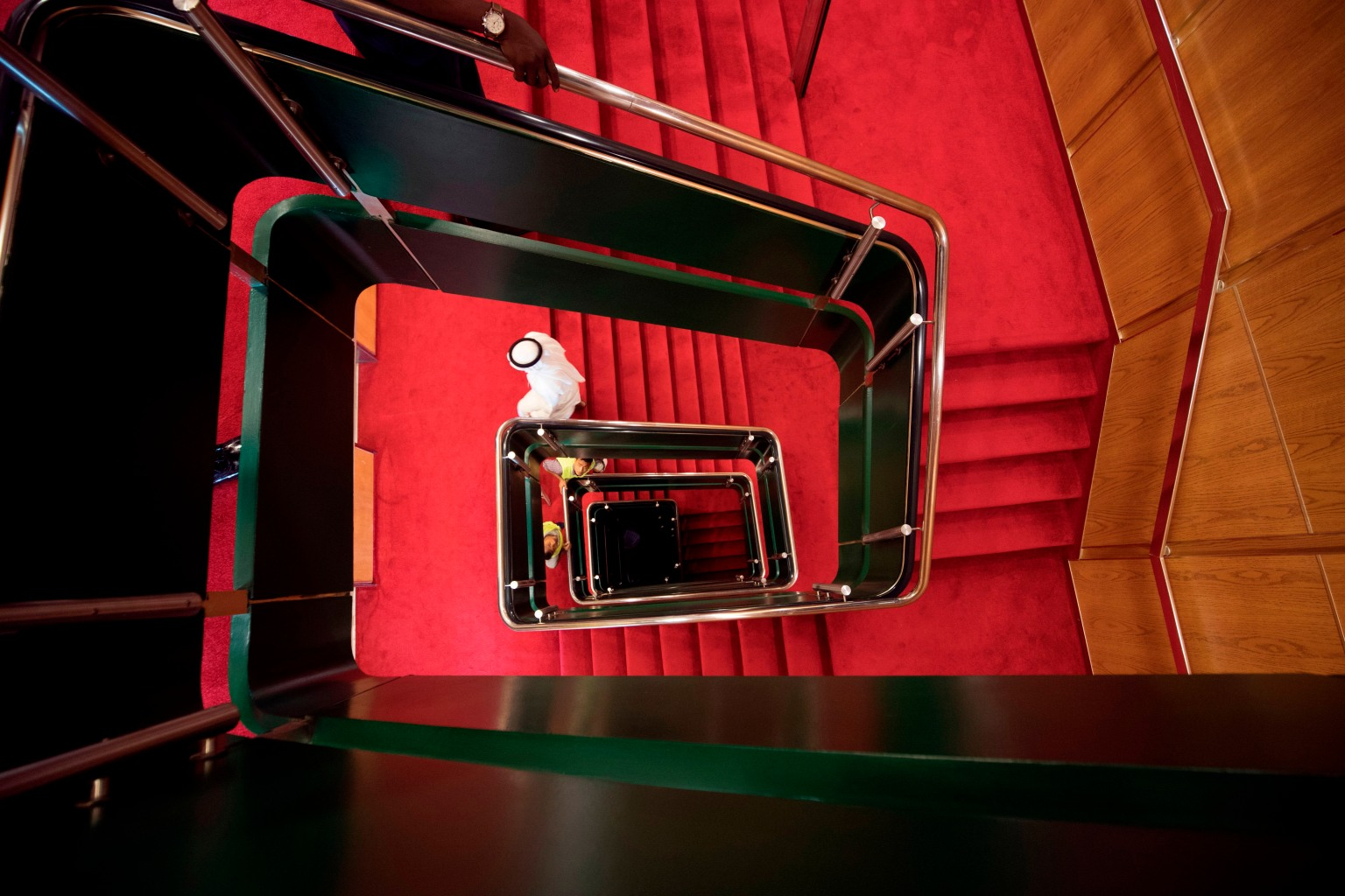 A lift system and stairwell allows guests to move between the 13 decks on The Queen Elizabeth 2 luxury cruise liner on April 18 at Port Rashid, Dubai. The refurbished ship will be moored permanently there as a floating hotel. KARIM SAHIB/AFP/Getty Images