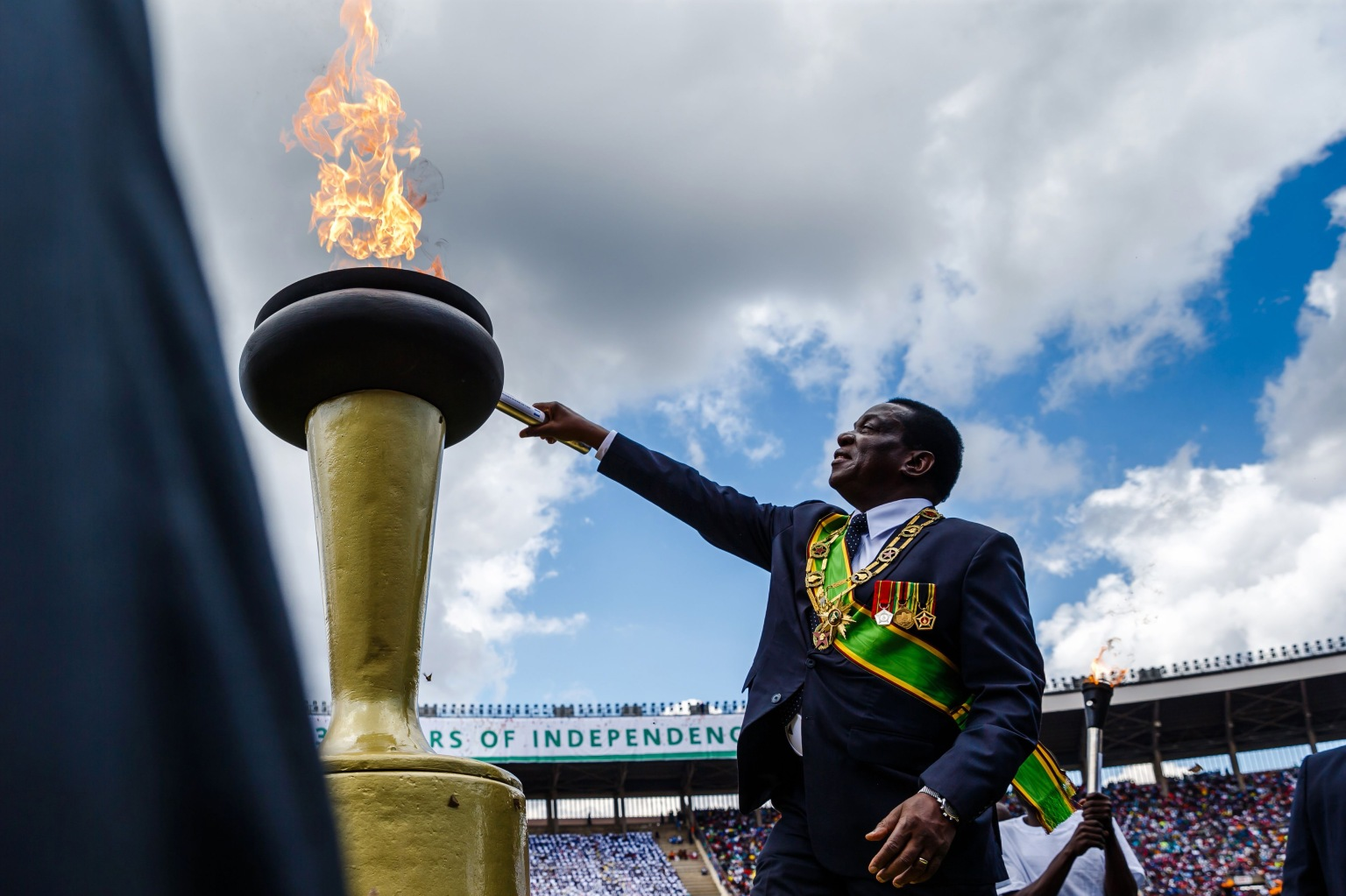 Zimbabwe President Emmerson Mnangagwa lights the Eternal Flame of Freedom during Independence Day celebrations at the on April 18 in Harare. Zimbabwe marked its first independence day since 1980 without Robert Mugabe in power, as Mnangagwa vowed to hold credible elections and turn around the southern African nation's troubled economy. JEKESAI NJIKIZANA/AFP/Getty Images