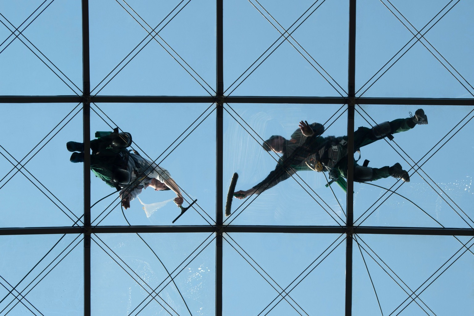 Workers clean the 88-foot-high glass roof of the World Trade Center in Dresden, Germany, on April 19. SEBASTIAN KAHNERT/AFP/Getty Images