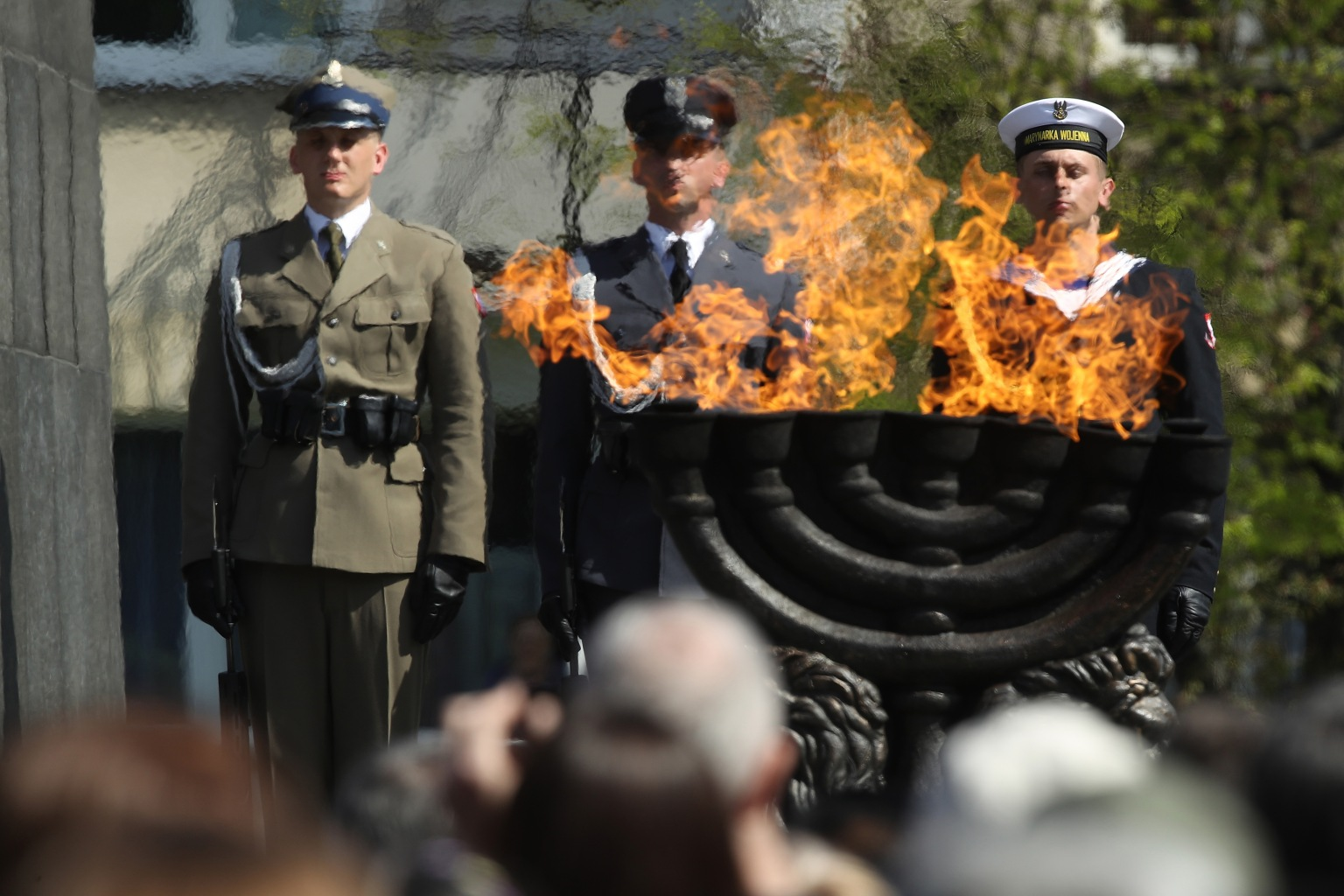 Polish soldiers attend a ceremony marking the 75th anniversary of the Warsaw Ghetto uprising on April 19. The ghetto confined Jews in horrific, deadly conditions during Germany's occupation of Warsaw during World War II. With assistance from Polish partisans, the Jews rose up and fought the Germans for several weeks until the Germans annihilated the ghetto, killing tens of thousands. Sean Gallup/Getty Images