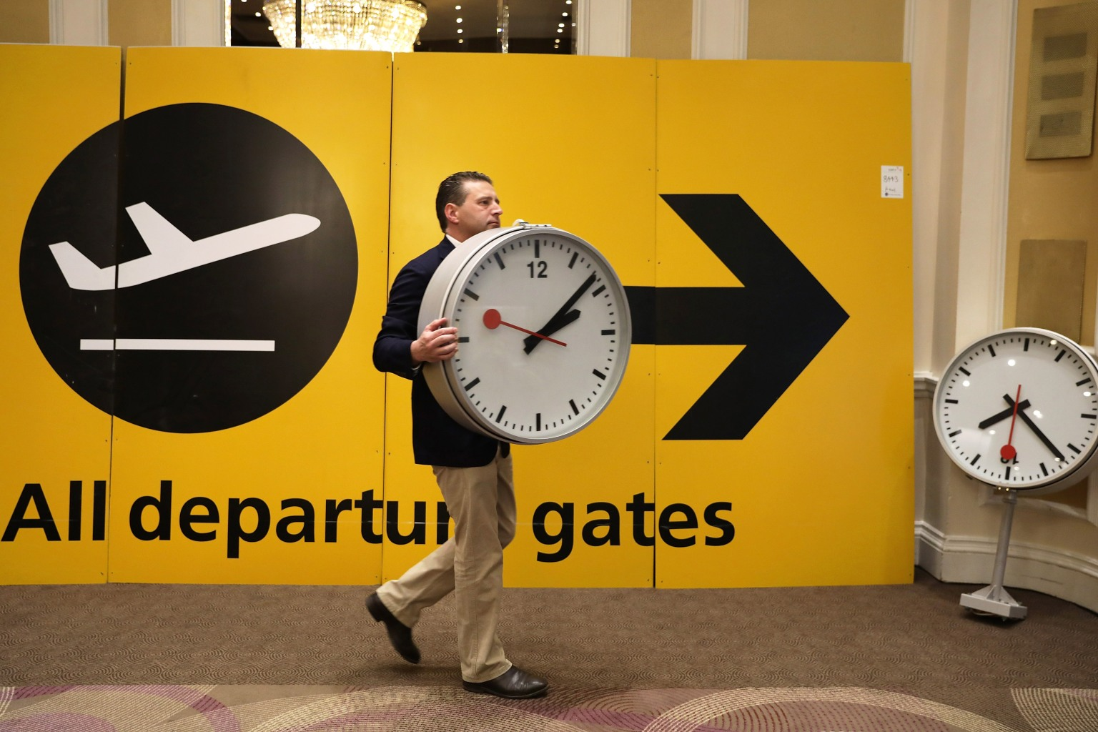Items are arranged during a preview of an auction at Heathrow Airport on April 20 London. Around 300 lots of memorabilia including clocks, signs, seats, desks, artwork and baggage carousels from Heathrow's Terminal 1, which closed in 2015, will be up for auction. Dan Kitwood/Getty Images