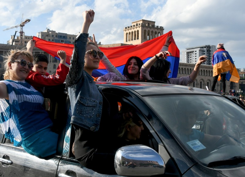 People celebrate Armenian prime minister Serzh Sarkisian's resignation in downtown Yerevan on April 23, 2018. (VANO SHLAMOV/AFP/Getty Images)
