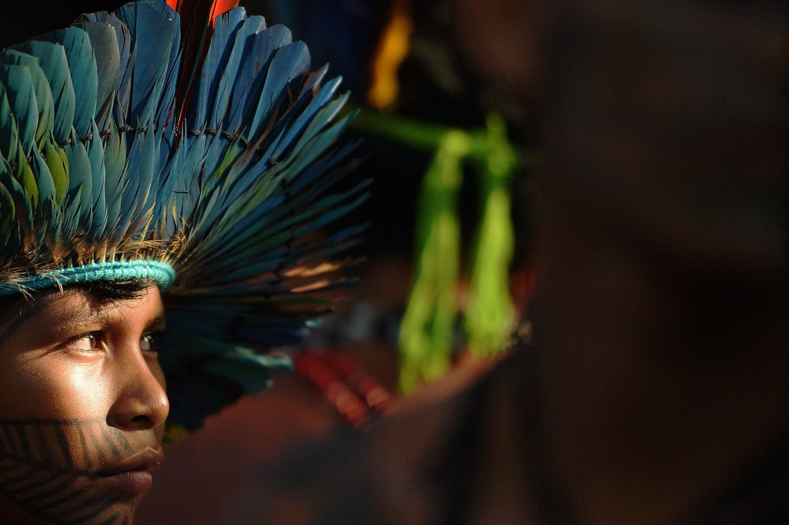 A boy from the Munduruku tribe in Brazil attends a meeting at the Acampamento Terra Livre (Free Land Camp) on April 24. Approximately 2,500 indigenous people from different tribes are taking part in Indigenous National Mobilization week, which seeks to tackle territorial rights' negotiations with the government. CARL DE SOUZA/AFP/Getty Images