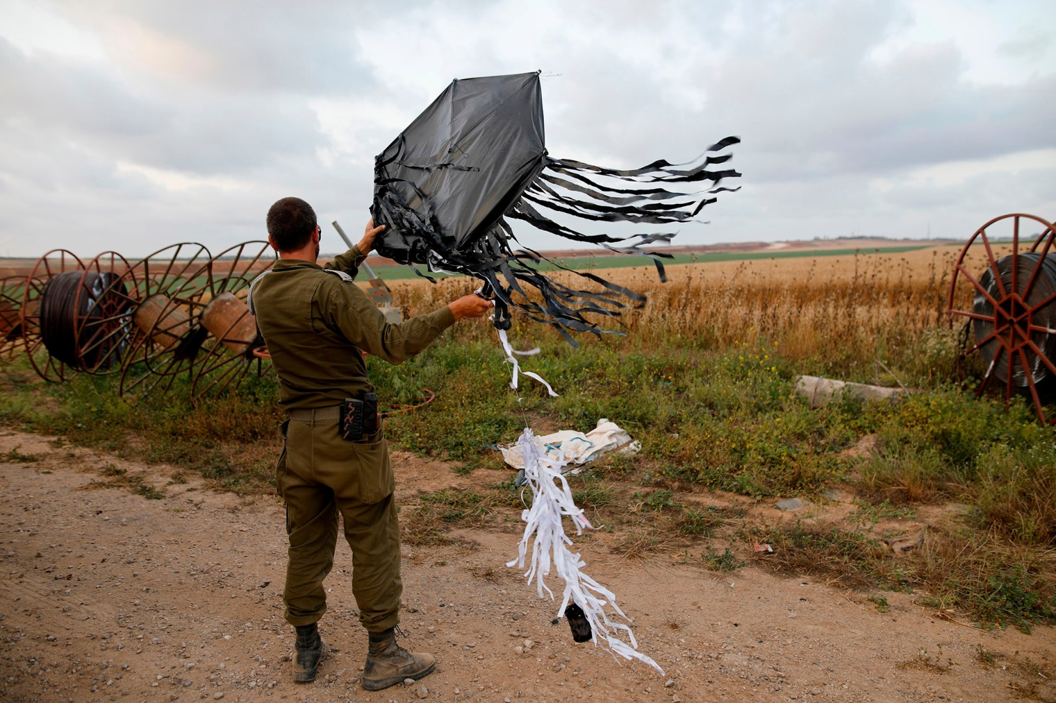 An Israeli soldier holds a kite flown over the border from Gaza in a tactic used by Palestinian protesters to start small fires in Israeli territories on the Israel-Gaza border near Kfar Aza on April 24. Tens of thousands of Palestinians have gathered at the border on consecutive Fridays to call for refugees to be allowed to return to their former homes now inside Israel. MENAHEM KAHANA/AFP/Getty Images