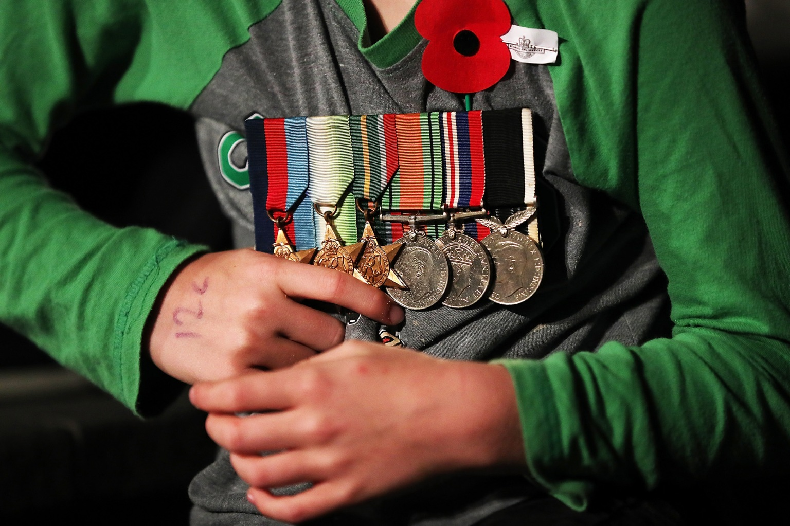 Seven-year-old George Sharp takes part in Anzac Day commemorations at the Auckland War Memorial Museum on April 25 in New Zealand. The event marks 102 years since the Australian and New Zealand Army Corp (ANZAC) landed on the shores of Gallipoli during World War I, a national holiday in New Zealand featuring a dawn service timed to the original landing. Fiona Goodall/Getty Images