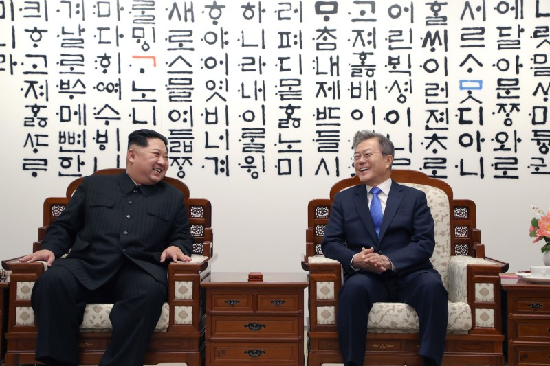 North Korean leader Kim Jong Un and South Korean President Moon Jae-in are in talks during the Inter-Korean Summit on April 27, 2018 in Panmunjom, South Korea. Photo by Korea Summit Press Pool/Getty Images