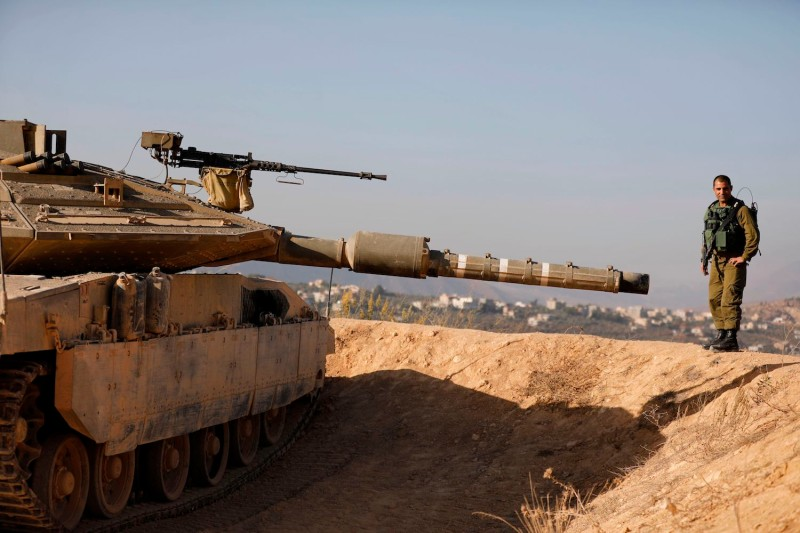 A picture taken on Nov. 16, 2017, shows Israeli Army officer Lt. Col Elad Efrati battalion commander standing next to a tank at an army position overlooking southern Lebanon in the northern Israeli town of Metula, along Israel's border with Lebanon. (Menahem Kahana/AFP/Getty Images)