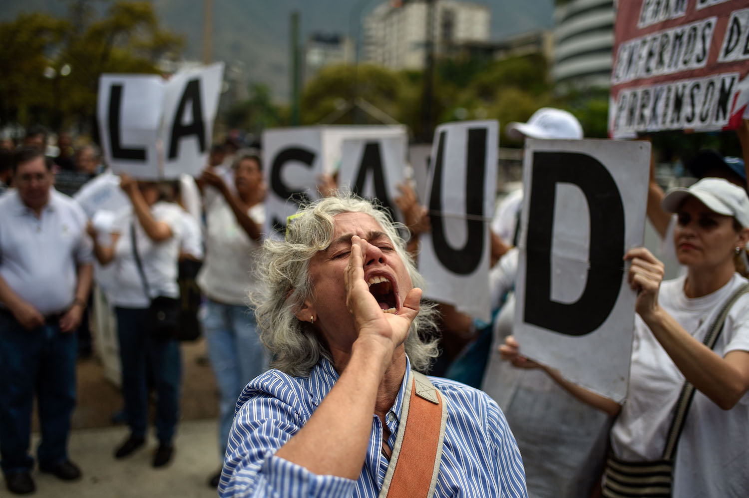 A woman chants slogans during an anti-government demonstration protesting for the shortage of medicines in Caracas on April 9, 2018. / AFP PHOTO / FEDERICO PARRA        (Photo credit should read FEDERICO PARRA/AFP/Getty Images)