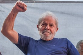 """Former President Luiz Inacio Lula da Silva gestures to supporters at the headquarters of the Metalworkers' Union on April 7, 2018 in the Sao Bernardo do Campo section of Sao Paulo, Brazil after a warrant for his arrest was issued. The  former president told the crowd """"I will comply with their warrant."""""""