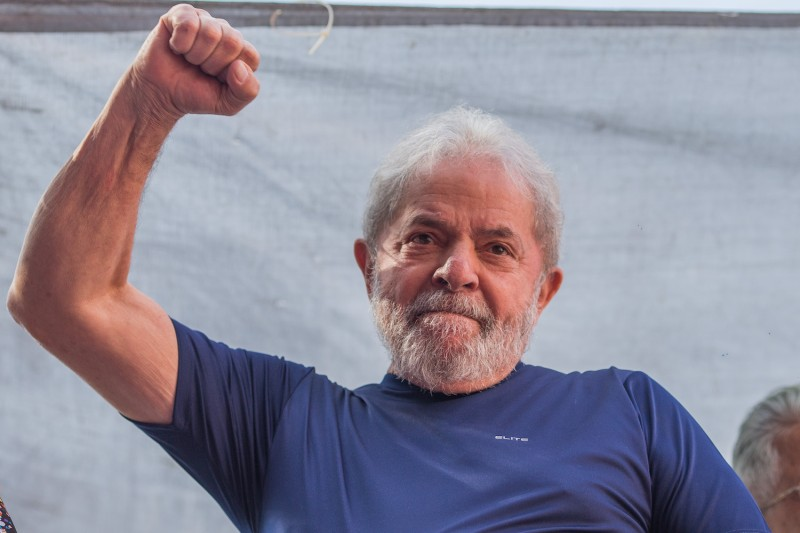 "Former President Luiz Inacio Lula da Silva gestures to supporters at the headquarters of the Metalworkers' Union on April 7, 2018 in the Sao Bernardo do Campo section of Sao Paulo, Brazil after a warrant for his arrest was issued. The  former president told the crowd ""I will comply with their warrant."""
