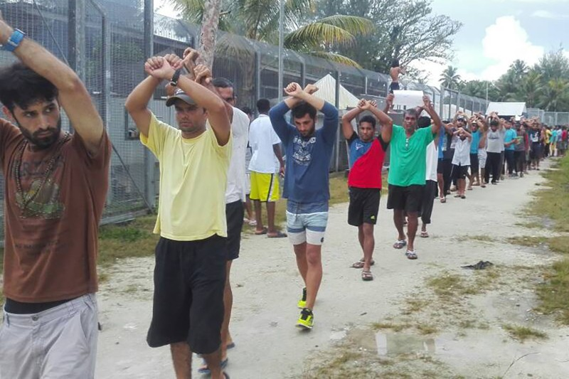 An image released November 13, 2017, shows detainees staging a protest inside the compound at the Manus Island detention center in Papua New Guinea.