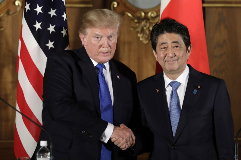 U.S. President Donald Trump shakes hands with Japan's Prime Minister Shinzo Abe during a news conference at Akasaka Palace in Tokyo on Nov. 6, 2017. (Kiyoshi Ota/AFP/Getty Images)