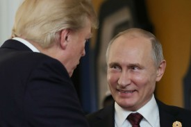 US President Donald Trump chats with Russia's President Vladimir Putin as they attend the APEC Economic Leaders' Meeting on Nov. 11, 2017. (Mikhail Klimentyev /AFP/Getty Images)