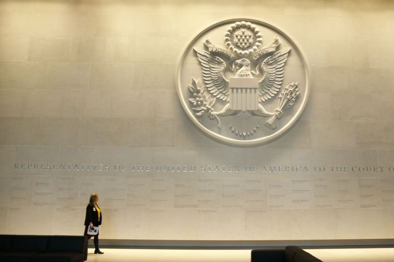A woman walks in the main lobby entrance featuring a large Department of State embossed seal during a press preview of the new United States Embassy building in central London on Dec. 13, 2017. (Alastair Grant/AFP/Getty Images)