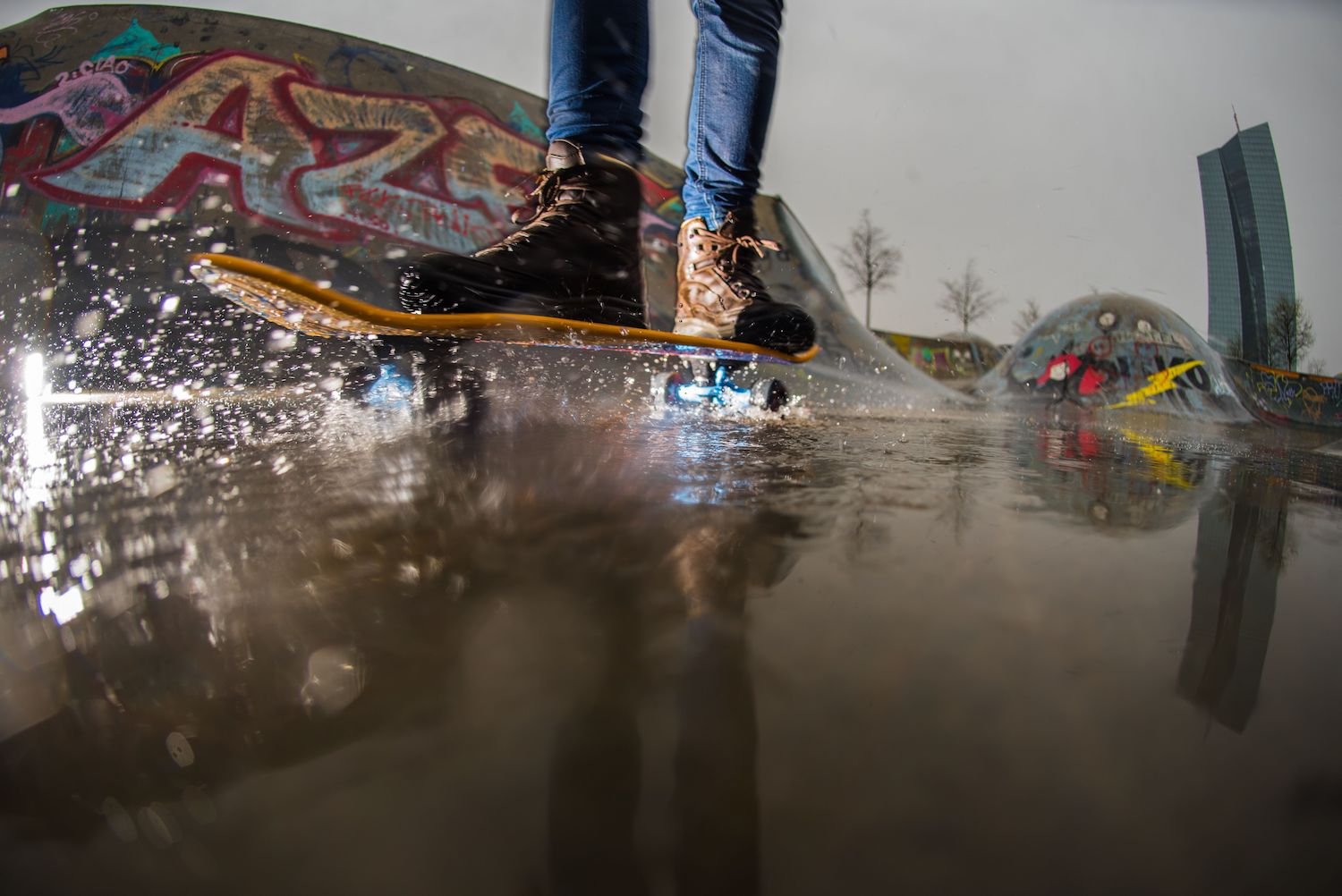 A picture taken with a fish-eye lens shows a youth skaking at a skate park on a rainy day on Apr. 13, 2018 in Frankfurt am Main. / AFP PHOTO / dpa / Andreas Arnold / Germany OUT        (Photo credit should read ANDREAS ARNOLD/AFP/Getty Images)