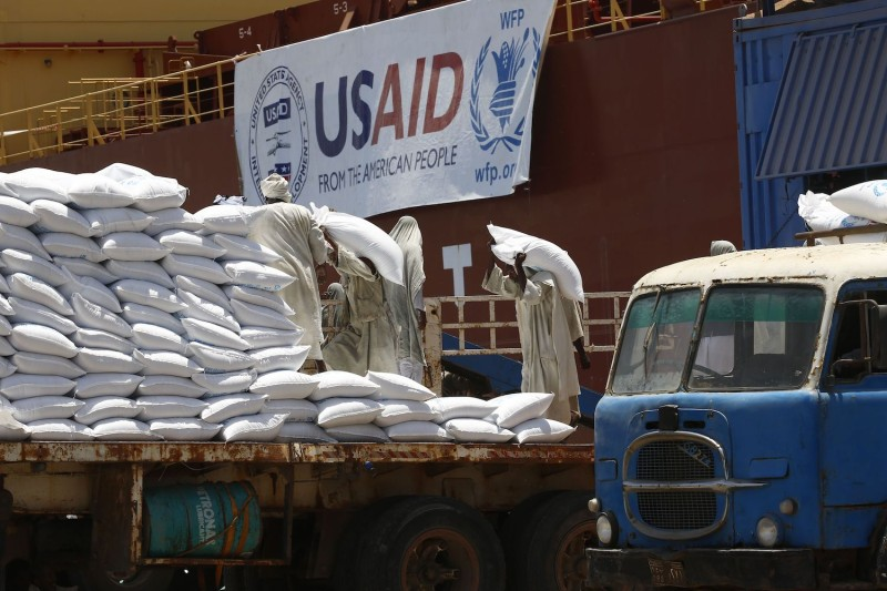 Sudanese dockers unload bags of food from U.S. ships carrying humanitarian aid supplies provided by USAID, in Port Sudan, Sudan on June 5, 2018.